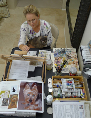 Animal portrait artist Lisa LaTourette works in oils